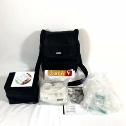Ameda breast pump kit and black bag with all accessories and